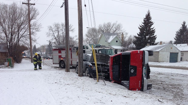 A collision at Ness Avenue and Kensington Street forced a truck onto its side.