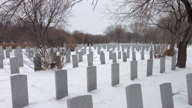 Snow blanketed Brookside Cemetery Saturday in advance of Sunday's Remembrance Day ceremonies. City crews said the cemetery would be plowed Sunday morning.
