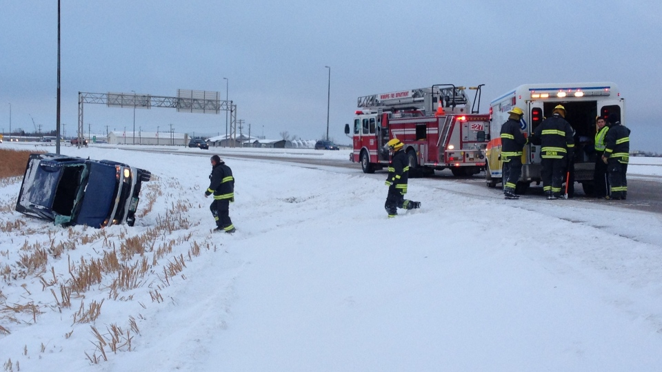 Emergency crews respond after a vehicle rolled on Lagimodiere Boulevard on Monday morning in Winnipeg.