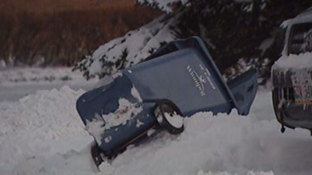 Residents in Southdale woke to overturned and half-buried garbage bins Tuesday morning after snow plows moved through the area.