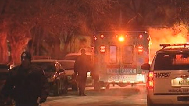 Police and emergency crews respond to the shooting  in the 400 block of Martin Avenue West in Elmwood in December 2009. Two men were killed and a third wounded.