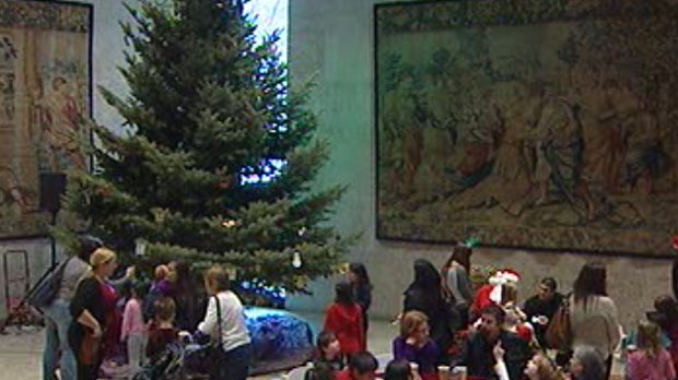 Winnipeggers apply handmade ornaments to the art gallery's holiday tree Sunday.