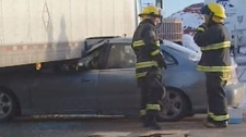 A car became pinned under a semi on Panet Road.