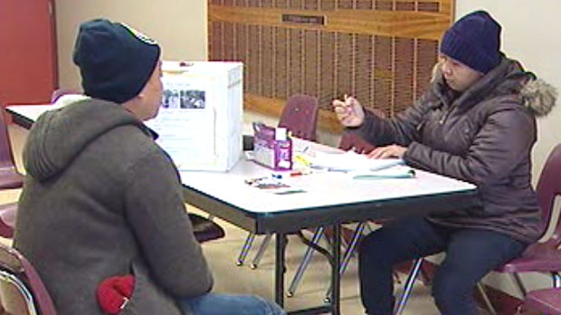 Volunteers take donations at the Philippine Canadian Centre in Winnipeg for typhoon victims.