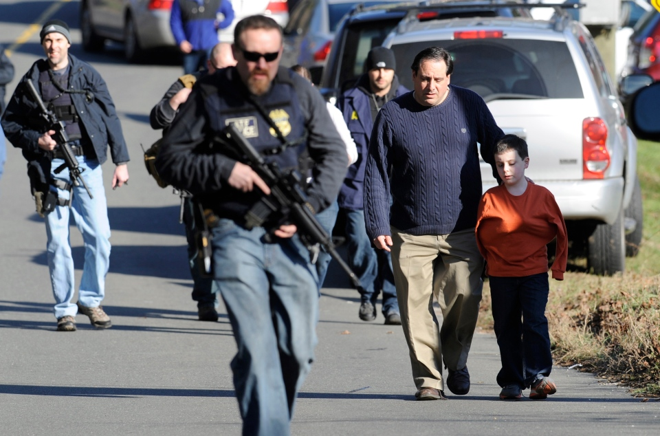 Parents leave a staging area after being reunited with their children following a shooting at the Sandy Hook Elementary School in Newtown, Conn., Friday, Dec. 14, 2012. (AP / Jessica Hill)