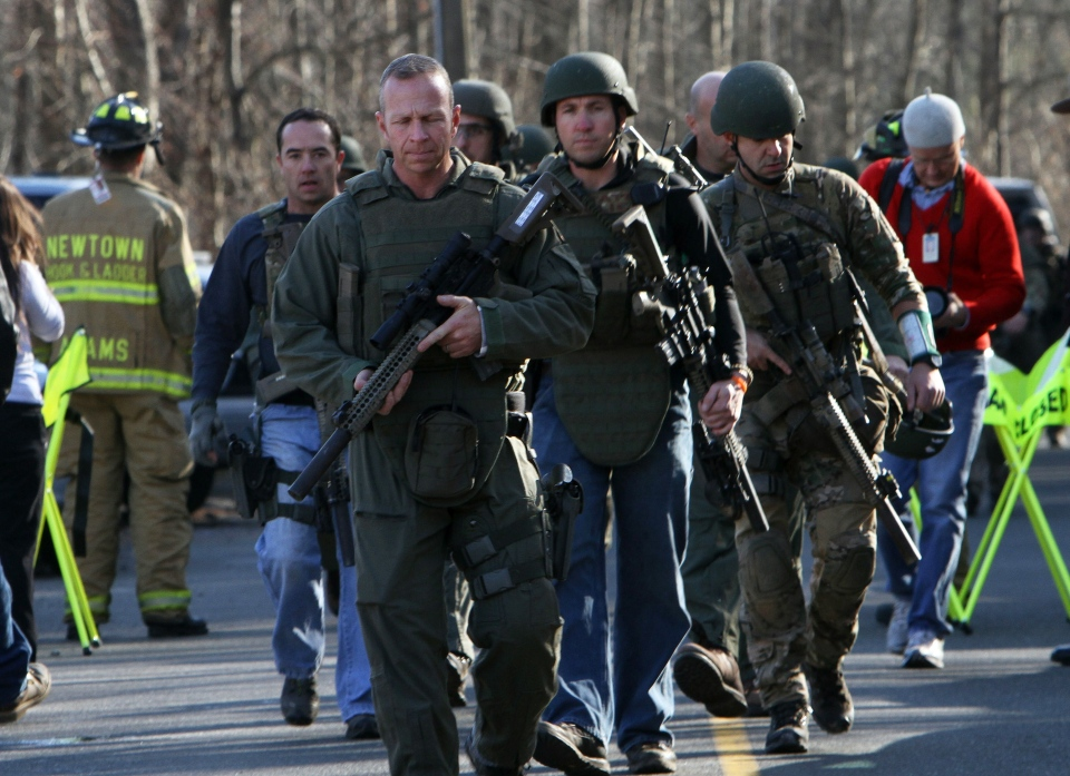 Heavily armed Connecticut State troopers are on the scene at Sandy Hook Elementary School in Newtown, Conn., Friday, Dec. 14, 2012. (The Journal News / Frank Becerra Jr.)