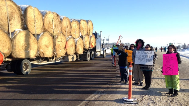 Demonstrators block traffic at the intersection of Highway 1 and Highway 16 as part of the national Idle No More campaign.