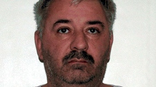 Iain Kenneth George Smy, 48, is wanted for failing to appear in a Brandon court to face sexual assault charges.