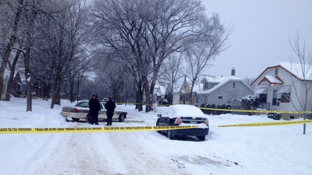 Police remained on scene Saturday afternoon on St. Catherine Street after a man was killed Friday evening in St. Boniface.