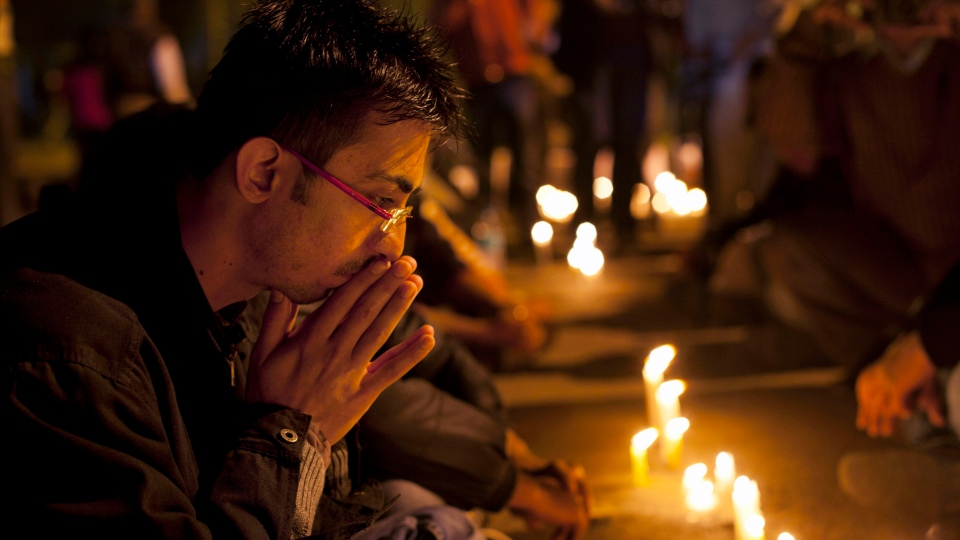 An Indian participates in a candle-lit vigil to mourn the death of a gang rape victim in New Delhi, India, Saturday, Dec. 29, 2012. (AP / Dar Yasin)