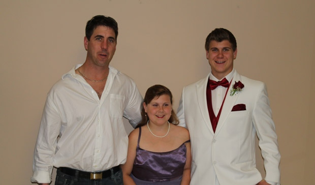 Greg Welch (left) and his children Jayda and Jordan are shown in a family photo from Jordan's graduation.