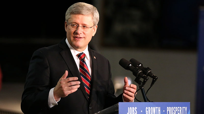 Prime Minister Stephen Harper speaks from the podium at Ford Motor plant in Oakville Ont. on Friday, Jan. 4, 2013. (Chris Young / THE CANADIAN PRESS)