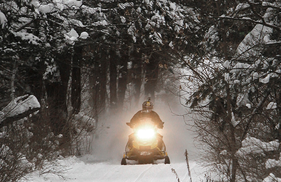 A snowmobiler is shown in this archive photo from 2012 in East Montpelier, Vt. (Associated Press Archive Photo/Toby Talbot)