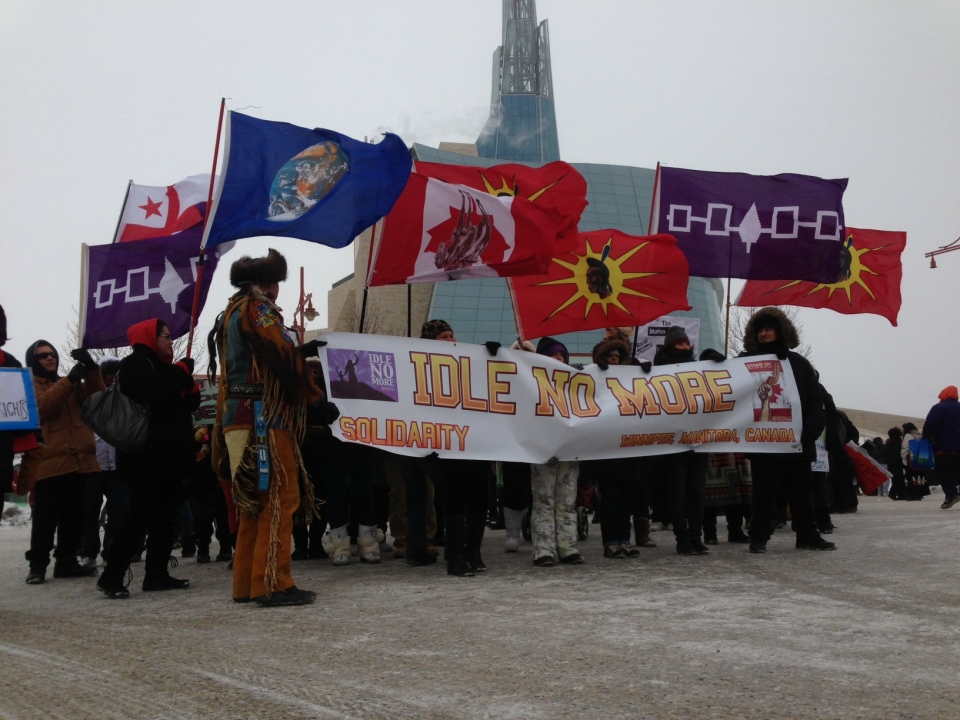 An Idle No More protest in Winnipeg blocks traffic Friday near the Canadian Museum for Human Rights.