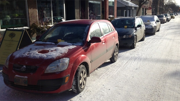 Ticketed vehicles are shown on Lilac Street in Winnipeg on Jan. 16, 2013.