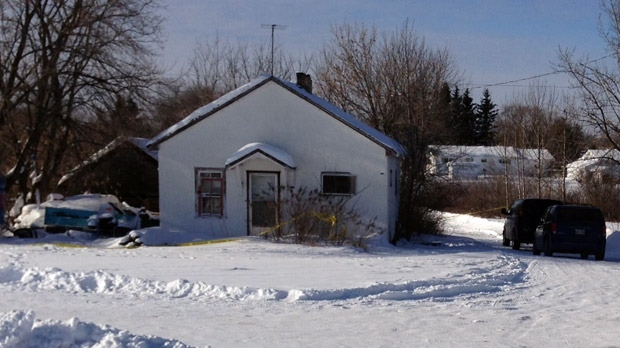 Police remained on scene on Jan. 22, 2013 in Ethelbert, Man. A woman's body was found on the weekend, while a man's body was later found during a search of the grounds.