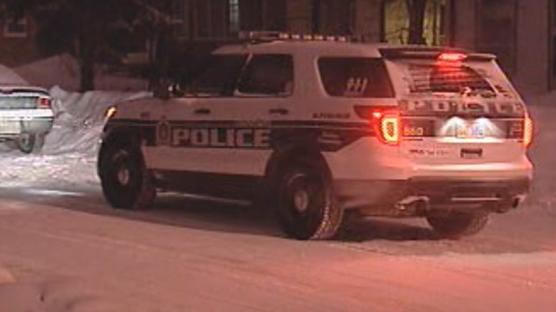 Winnipeg police investigate in the 500 block of Kylemore Avenue in Fort Rouge early Jan. 24, 2013. The investigation led them to a second location in the first 100 block of Pear Tree Bay in South St. Vital and a woman's body was found in a vehicle.