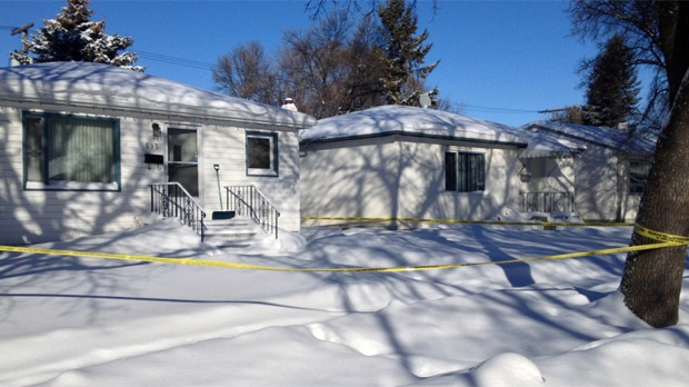 Police tape surrounds a home in the 500 block of Kylemore Avenue in Winnipeg on Jan. 25, 2013.