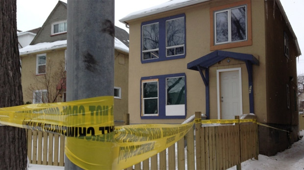 Police tape surrounds a home on Sherbrook Street in Winnipeg. Officers were investigating in the area following a shooting on Main Street on Feb. 15, 2013.