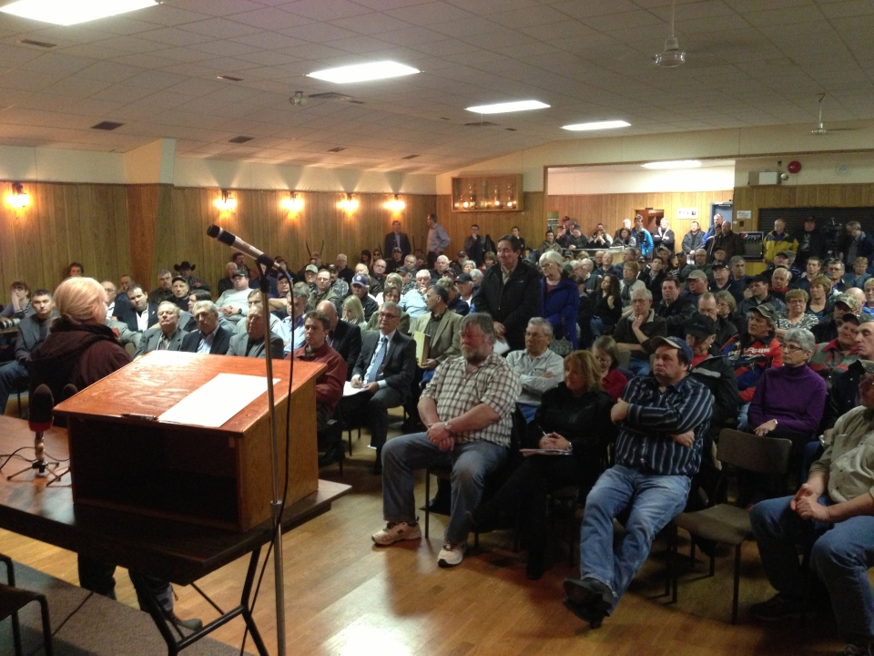 A few hundred people gathered in Marquette Friday to hear about provincial flood compensation.
