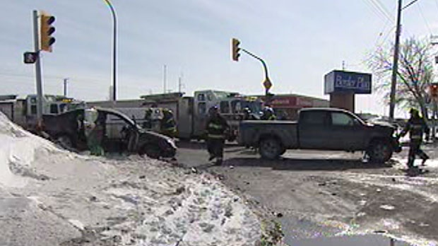 A car and a pickup truck collided during the noon hour, leaving bits of twisted metal on the road.