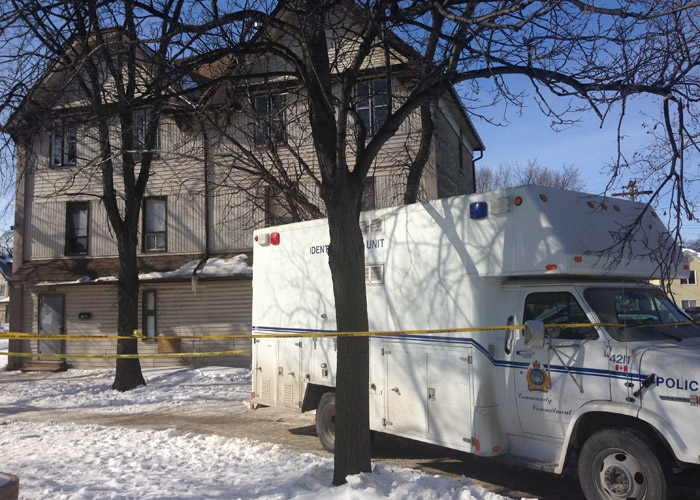 Winnipeg police continued to investigate at the residence in the 600 block of Balmoral on Feb. 27, 2013, the day after a man's body was found inside.