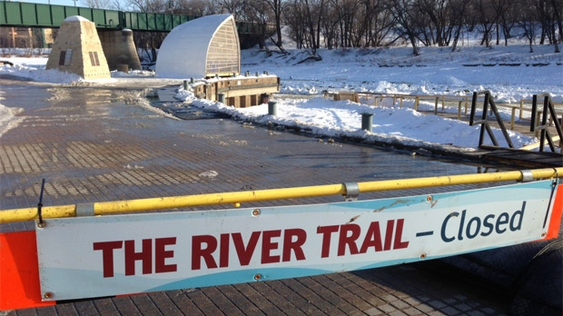 The recent warm up in temperatures has meant that officials have had to close the river trail in Winnipeg with river ice starting to melt. A sign shows the closure on Feb. 27, 2013.