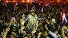 Egyptians celebrate as they carry an army soldier in Tahrir Square after President Hosni Mubarak resigned and handed power to the military in Cairo, Egypt, Friday, Feb. 11, 2011.(AP / Ahmed Ali)