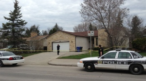 Winnipeg police investigate at a home in the 4300 block of Roblin on May 18, 2013. Homicide and forensic units were on scene.