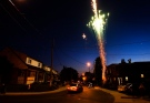 Residents light fireworks along their street during the Victoria Day long weekend in Toronto on Monday, May 24, 2010. (THE CANADIAN PRESS/Nathan Denette)