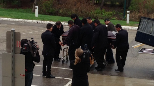 The body of Elijah Harper arrives at the Legislative Building on Monday, May 20.