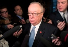 Senator Jacques Demers speaks to media following Caucus on Parliament Hill Tuesday May 21, 2013 in Ottawa. (Adrian Wyld / THE CANADIAN PRESS)