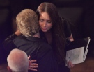 Widow Sharlene Bosma receives a hug at a memorial in Hamilton, Ont., Wednesday, May 22, 2013, for her husband Tim Bosma, the Hamilton, Ont., man found dead after he took two men on a test drive. (Nathan Denette / THE CANADIAN PRESS)