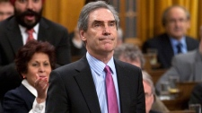 Liberal Leader Michael Ignatieff votes in favour of a Liberal contempt of Parliament motion in the House of Commons on Parliament Hill in Ottawa, Friday March 25, 2011. (Adrian Wyld / THE CANADIAN PRESS)