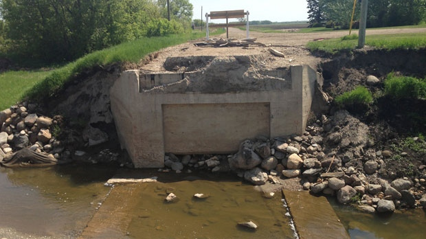 Crews were called to the crash at washed-out Road 142 North in the RM of Dauphin around 8 p.m. on June 4, 2013.