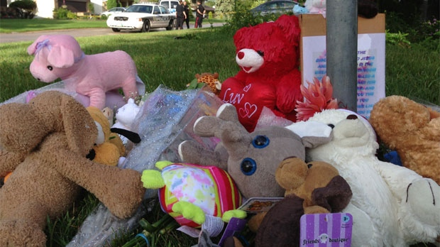 A memorial for the two young children who died is shown outside a home on Coleridge Park Drive in Winnipeg, Man.