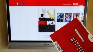 A Netflix DVD envelope and Netflix on-screen television menu are shown in Surfside, Fla., Oct. 1, 2011. (AP / Wilfredo Lee)
