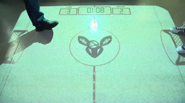 Winnipeg company Po-Motion is looking for funding to market its interactive projector, Lumo, which allows users to play games on any surface.