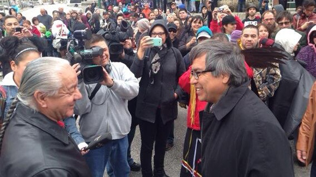 UN Special Rapporteur on the Rights of Indigenous Peoples James Anaya (right) meets with members of Winnipeg's aboriginal community during a massive street dance at Portage and Main on Saturday, Oct. 12, 2013.
