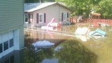 Homes in Minot, N.D. are hit by flood waters on June 23, 2011.