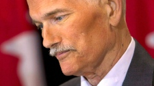 NDP Leader Jack Layton pauses at a new conference in Toronto on Monday, July 25, 2011. (Nathan Denette / THE CANADIAN PRESS)
