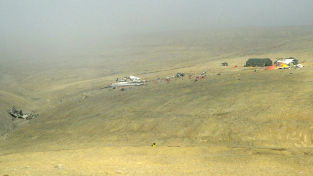 The crash site of First Air flight 6560 is viewed from the Resolute Airport in Resolute, Nunavut on Tuesday, Aug. 23, 2011. (Sean Kilpatrick / THE CANADIAN PRESS)