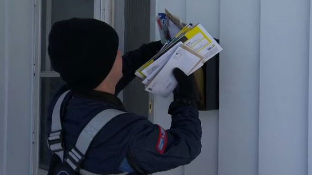 Canada Post says to accommodate those who can't get to a community mailbox, home delivery will still be done for those customers once a week. (file image)