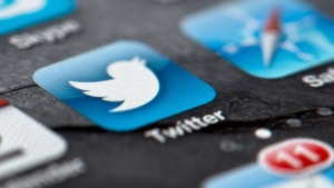 A smartphone display shows the Twitter logo in Berlin, Germany on Feb. 2, 2013. (AP / Soeren Stache)