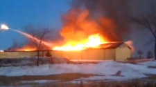 Winkler fire destroys building
