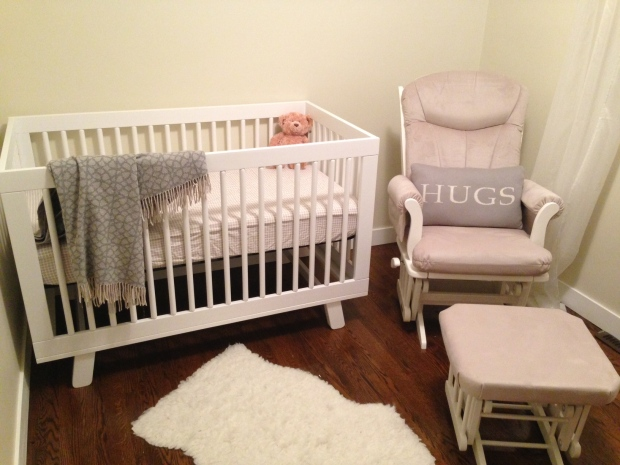 The nursery isn't quite complete, but with eight weeks to go before Nicole's due date, she's thrilled the crib is finally set up!