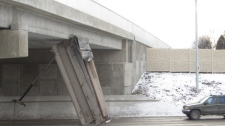 The dump truck hit the Rothesay overpass around 2 p.m. on Dec. 20 in Winnipeg. (photo courtesy Brian Acklom)