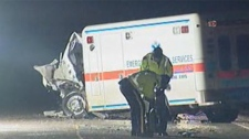 Investigators examine the scene of a collision involving an ambulance near Souris, Man. on Jan. 5, 2012.
