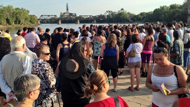 Hundreds of people gathered at a vigil for Tina Fontaine and Faron Hall in Winnipeg on Aug. 19, 2014.