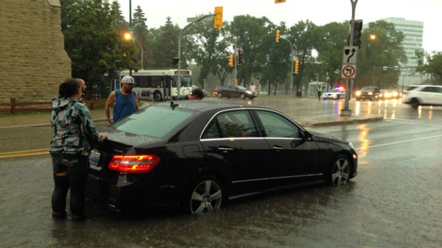 Several vehicles became stuck in flooded streets around Winnipeg in the storm on Aug. 21, 2014.
